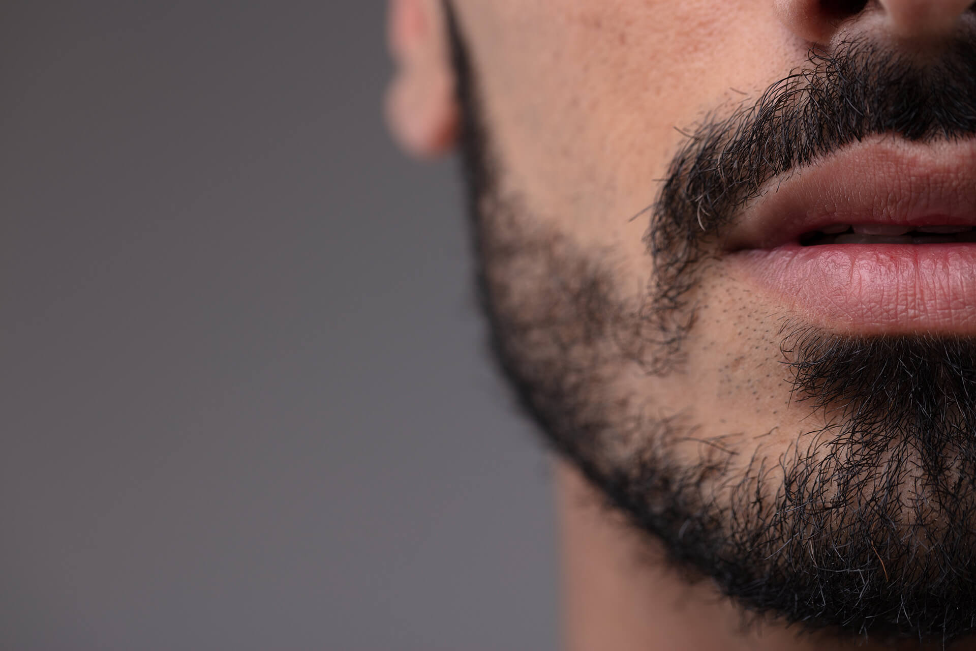 Confident man lip filler